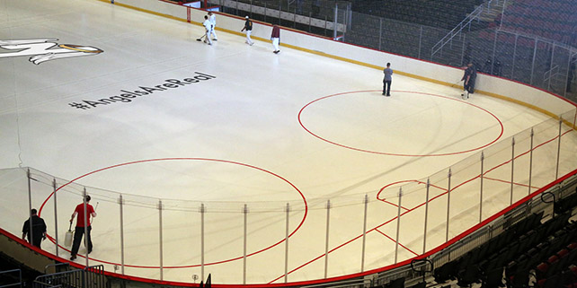 Learn Photoshop and create pictures with realistic overlays like this picture of a team logo on ice.